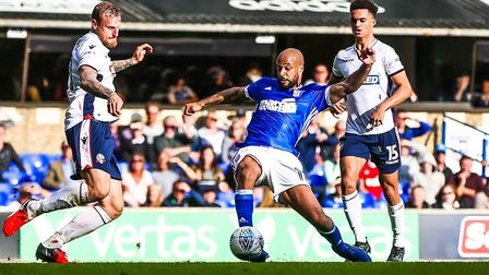 David McGoldrick makes contact with the ball, to send it into top the corner of net for Town's secon
