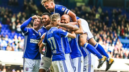 Cole Skuse is in the centre of his celebrating teammates after scoring to give Town a 1-0 lead. P
