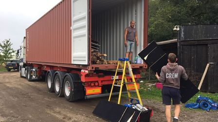 Members of the Events Under Canvas team loading the container with the tipi and bell tents destined