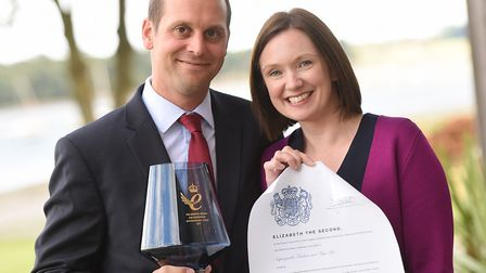 Superyacht Tenders & Toys founders Josh and Claire Richardson with their Queen's Award trophy and sc