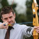 Chris tries his hand at archery with GB star Nicky Hunt.