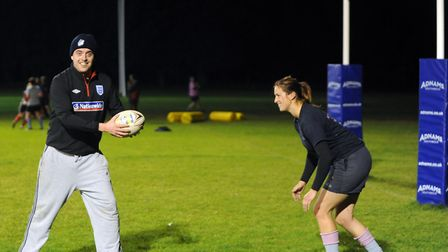 Chris, about to be tackled by Woodbridge Amazons' skipper, EJ Stearn