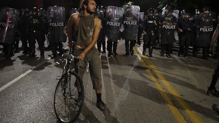 Protesters and police line-up in St Louis. Picture: AP/JEFF ROBERSON