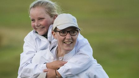 YORKSHIRE OPPOSITION: Fourteen-year-old Mia Eales-Smith gets a piggy-back from England international