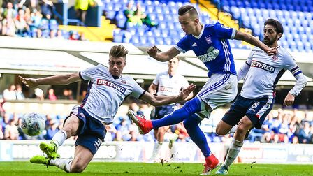 Ipswich Town's Bersant Celina takes a shot against Bolton on Saturday. Photo: Steve Waller