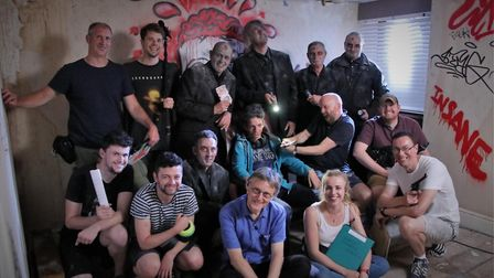 Grace Diggins (front row with clipboard) with cast and crew on the Film Suffolk production The Haunt