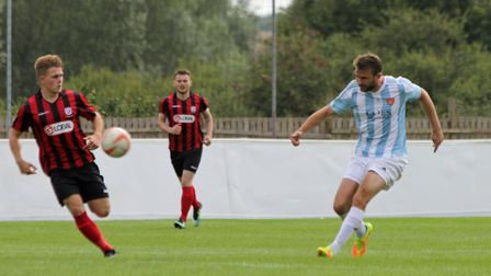 Joe Francis, right, fires in an effort on goal for Felixstowe at Coggeshall. Pictures: DAVID BAILEY