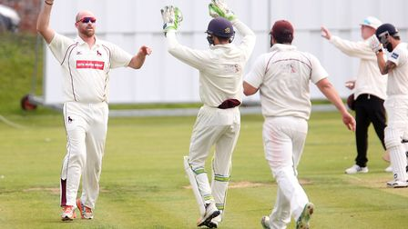 Sudbury's Tom Huggins celebrates a wicket on his way to figures of 10-5-23-4 in Saturday's big win o