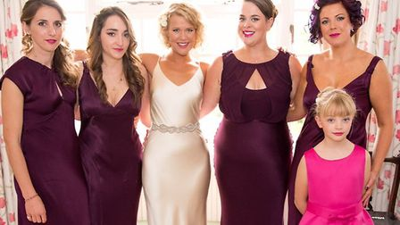 Becky pictured in the centre with her bridesmaids and sister Sophie, to her right. Picture: NICK REA