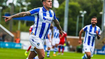 Sammie Szmodics wheels away after scoring to give the U's a 1-0 lead against Crawley. Picture: STEVE