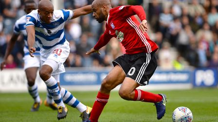 David McGoldrick tries to sell a first half dummy to QPR defender Alex Baptiste Picture Pagepix