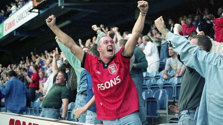 Ipswich Town fan celebrates Town's first goal as the blues beat QPR 2-1 at Loftus Road in Ipswich