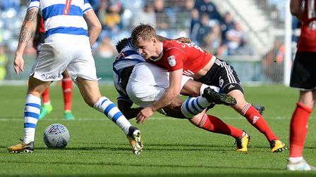 Callum Connolly rugby tackles Kazenga LuaLua during the second half at QPR Picture Pagepix