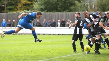 Ollie Hughes scores with a header. Picture: RICHARD MARSHAM