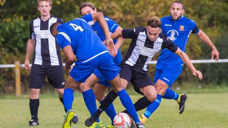 Callum Sinclair in the thick of the action for Woodbridge