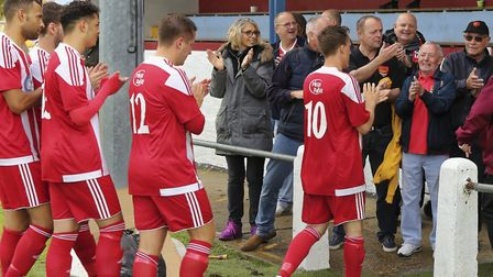 Happy Felixstowe fans clap off their team after the win at Thetford.