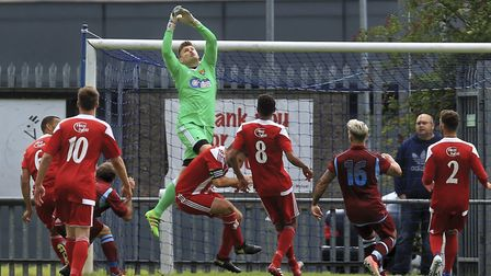 Seasiders' 'keeper Danny Crump climbs highest to claim the ball for the Seasiders. Photo: STAN BASTO