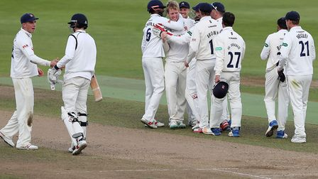 Essex's Simon Harmer is congratulated after taking the final Warwickshire wicket during the Specsave