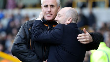 Ian Holloway (right) and Mick McCarthy embrace when managers of Blackpool and Wolves respectively. P