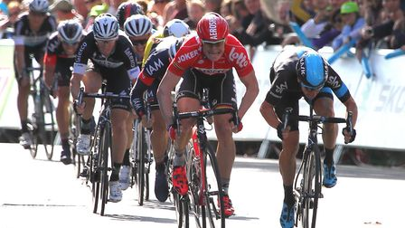 Stage winner Andre Greipel (red) sprints to the finish of stage seven of the Tour of Britain in Ipsw