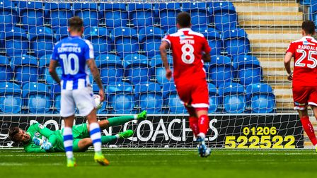 Sam Walker saves Mark Randall's second-half penalty, following a foul by Ryan Innis, during the 3-1