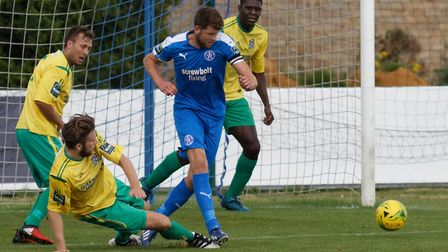 Leiston captain Tom Bullard plays the ball out of defence. Photo: PAUL VOLLER