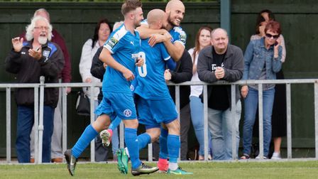 Matt Blake celebrates with his Leiston team-mates after scoring for the Blues against Thurrock.