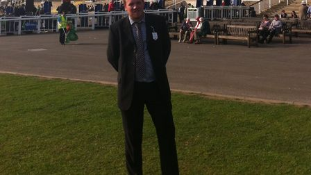 Racing fan Josh pictured in front of the Millennium Grandstand on the Rowley Mile at Newmarket. This