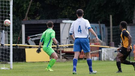 Amar Lewis (far right) watches his header enter the net for Stowmarket's first goal against Enfield