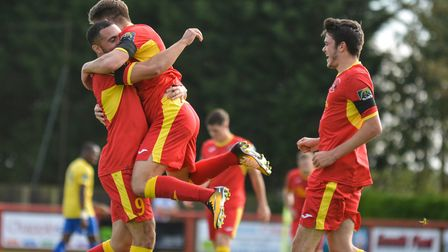 Needham celebrate a goal in their 2-2 draw with Enfield Town. Picture: BEN POOLEY