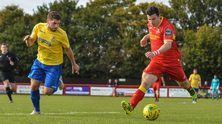 Needham's Jack Simmons, right, on the attack against Enfield. Picture: BEN POOLEY