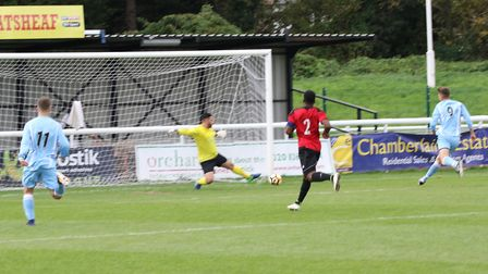 Mark Ray puts Woodbridge Town ahead, but they were beaten 6-2 by Enfield Borough. Picture: PAUL LEEC