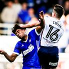 Bolton Wanderers Josh Cullen man handles Tom Adeyemi during the Ipswich Town v Bolton Wanderers game