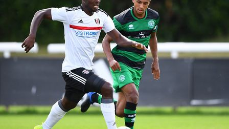 Brandon Comley, right, in action for QPR. He has no problem with doing the 'nitty-gritty' in the U's