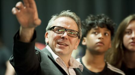 James Hirst as Mr Briggs, the authoritarian assistant head teacher, with the young company taking pa