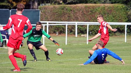 Framlingham's Danny Smith beats Lewis Wood to the ball.