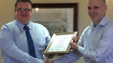 Will Durrant receiving his Master Maltster Award from Richard Broadbent, a member of the Examining B