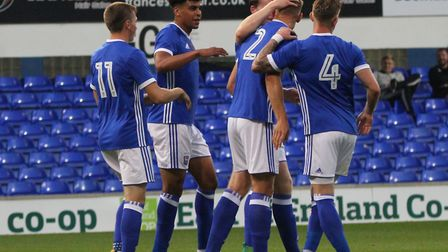 Luke Woolfenden celebrates his goal with his team mates. Picture: Ross Halls