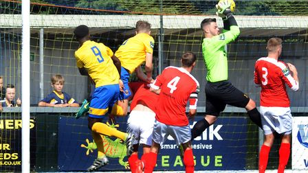 Safe hands from Mildenhall goalkeeper Sam Roach in their clash at Sudbury. Pictures: ANDY ABBOTT