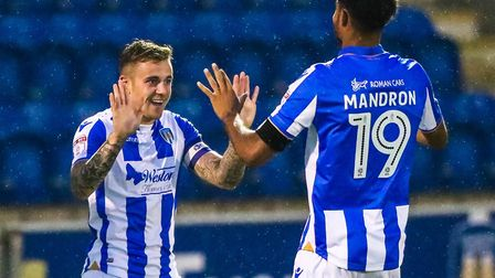 Sammie Szmodics celebrates with team-mate Mikael Mandron after giving the U's a 1-0 lead. Picture: