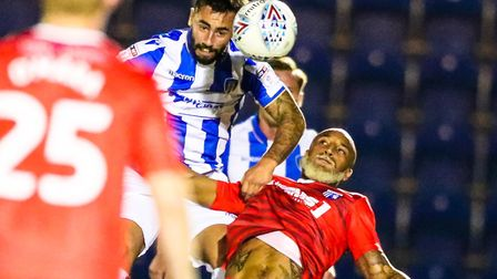 Lewis Kinsella battles with Josh Parker during the recent Checkatrade Trophy match against Gillingha