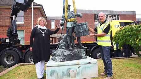 The Drummer Boy statue outside Suffolk Coastal's old building in Woodbridge being removed for restor