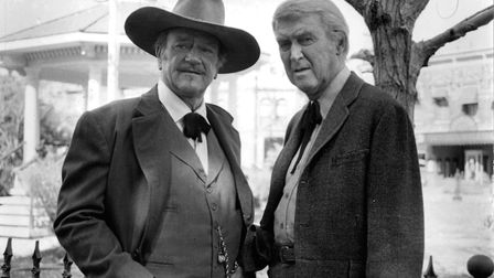 John Wayne, in his final film role, as dying gunslinger JB Books with James Stewart as the town doct