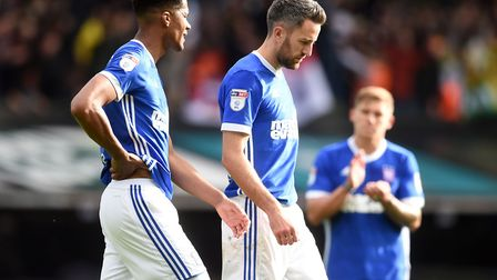 Jordan Spence and Cole Skuse walk off dejected after Ipswich Town's 1-0 home defeat to rivals Norwic