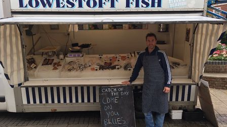 Ipswich Town FC fan Matthew Wylds at his fish stand in Beccles. Picture: Dean Mayhall.