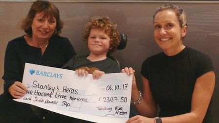 Stanley recieves a cheque after money was raised at the Tendring Blue Ribbon Awards night