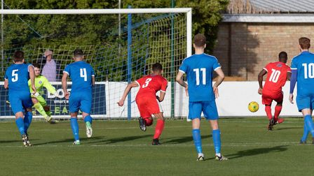 Adam Yusuff scores his first penalty to give Folkestone a 4-0 half-time lead. Picture: PAUL VOLLER