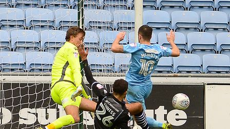 Ryan Inniss makes a great interception to deny home striker Marc McNulty during the U's 0-0 draw at