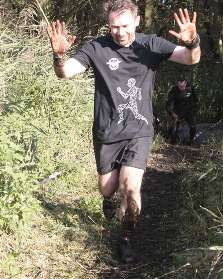 A runner takes on The Suffolk Whole Hog. Picture: NIGE BROWN
