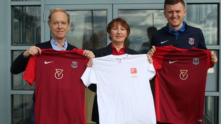 Richard and Jenny Bugg with Suffolk FA's James Morley